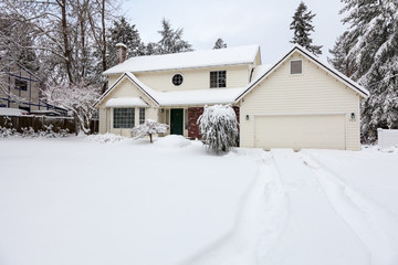 Residential home.  Average american two story residential home covered with snow during winter storm.