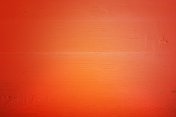 Orange wood background, with applied dark vignette filters.