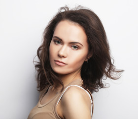 young woman wearing casual clothes, posing on white background