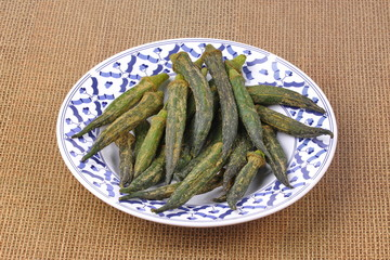 Crispy Okra dried seasoning on Thai pattern dish.