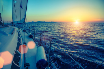 Fototapete - Sailing yachts boat at dusk in the sea.