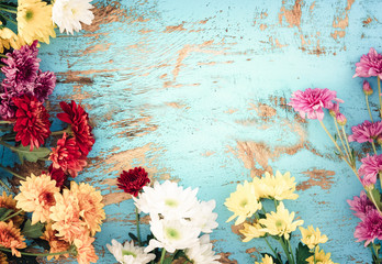 Wall Mural - Colorful flowers bouquet on vintage wooden background, border design. vintage color tone - concept flower of spring or summer background