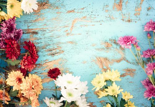 Wall mural Colorful flowers bouquet on vintage wooden background, border design. vintage color tone - concept flower of spring or summer background
