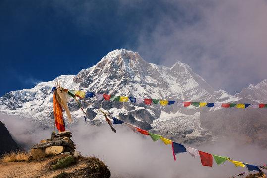 Annapurna I (8,091m) with prayer flag from Annapurna base camp ,Nepal.