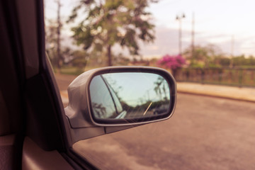 Wing mirror while driving. vintage filtered