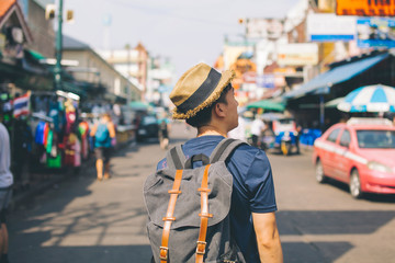 Young Asian traveling backpacker in Khaosan Road outdoor market