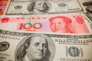 Chinese Yuan Note And U S Dollar Background Exchange Rate Concept