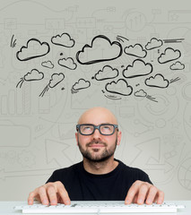Cloud icons going out of the head of a Young attractive bold man