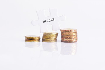 White missing puzzle and gold coins with holiday, copyspace area