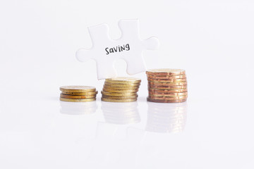White missing puzzle and gold coins with saving, copyspace area