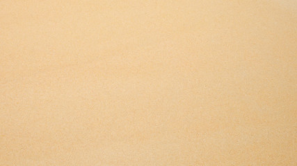 Top view of sand texture. Sandy beach for background. Wall mural