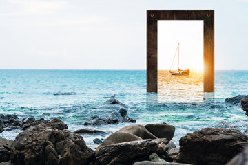 Seascape with wooden frame with sailboat and sunset