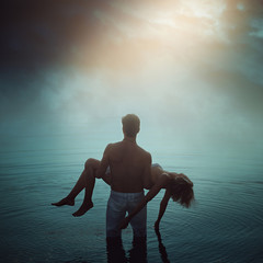 Man in ethereal water with dead lover