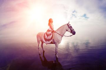 Beautiful woman on a horse. Horseback rider, woman riding horse