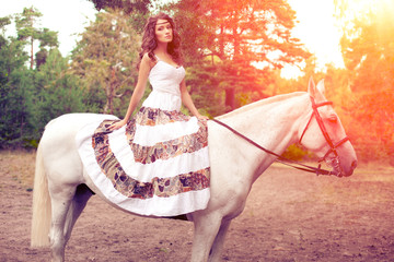 Young woman on a horse. Horseback rider, woman riding horse