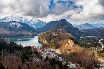 Fotobehang Rio de Janeiro Panoramic view of scenic idyllic winter landscape in the Bavarian Alps at famous mountain lake Alpsee, Fussen, Allgau, Upper Bavaria, Germany