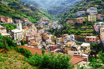 One of Cinque Terre villages - Riomaggiore is located amidst green hills in Liguria, Italy.