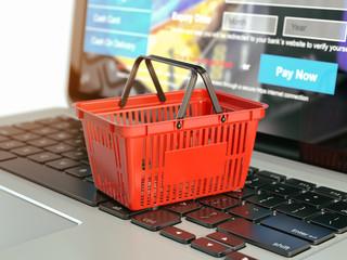 Poster Online shopping e-commerce concept. Shopping basket on laptop ke