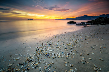 Panoramic view of sunset at Sungai Batu beach, Teluk Kumbar