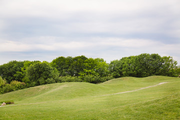 Summer or spring landscape with green hills and trees