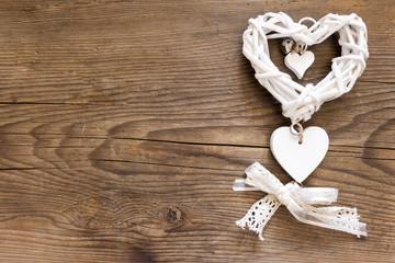 White heart on the wooden background