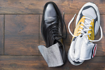 Work life balance - elegant business shoe (oxford style) and a running shoe