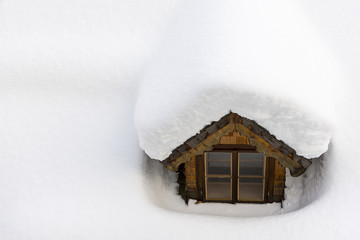 Roof Window Covered with Winter Snow. Thermal Insulation Concept.