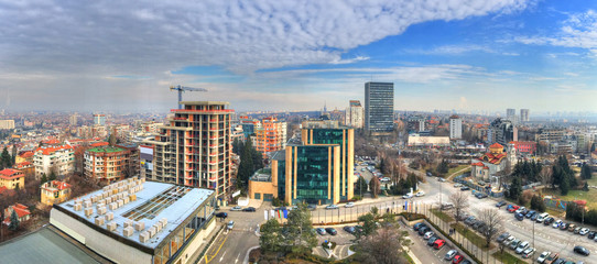Aerial view over urban skyline and  industrial sites under construction in Sofia, capital of Bulgaria Wall mural