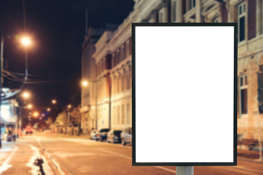 Blank mock up of vertical street poster billboard sign with copy space for your text message or content on city background
