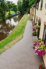 Canalside cottages and narrowboats on the Llangollen branch of the Shropshire Union canal  in the UK