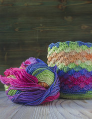 Pink, violet, magenta, white and green bag and yarn ball. Cotton yarn for knitting, crochet. The beginning of bright bag