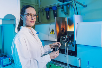Beautiful Woman Scientist in her lab performing Chemistry experiments
