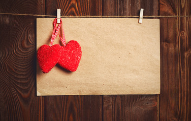 Card to day of St. Valentine. blank paper sheet and red heart on