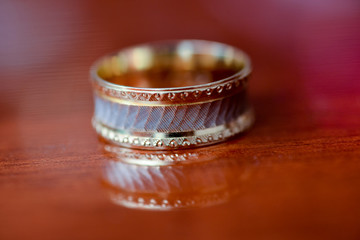 Wedding ring placed on the table in light side