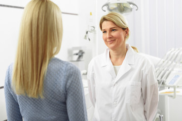 Woman visiting dentist in dental clinic