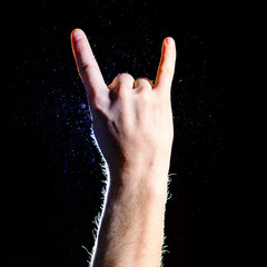 Male, man, hand raised showing a heavy metal rock sign, trend, life to the fullest, life style, flat, on black background
