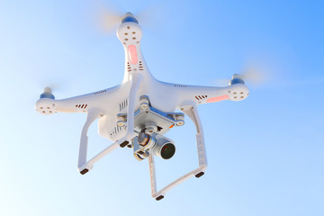 Drone quadrocopter with high resolution digital camera. New tool for aerial photo and video.