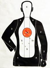 Paper target at the gun ranch after firing practice