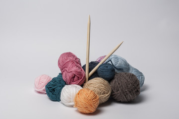 Balls of yarn for knitting with the wooden needles
