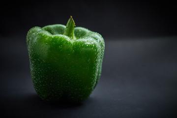 Fresh green pepper on black background