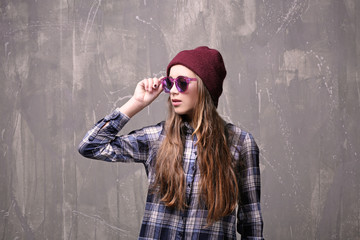 Pretty teenager girl on color background