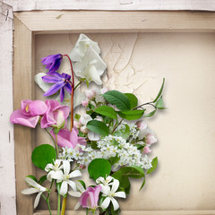 Bouquet of spring flowers on a vintage background