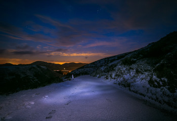 Wintry Landscape at Night with Empty Road and Starry Sky