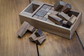 Wooden Block Brain Teaser Puzzle on Wood Background Spread Out