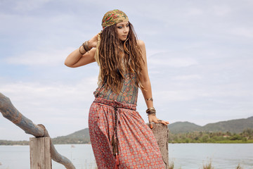 gypsy style young woman outdoors
