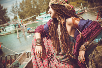 happy gypsy style young woman outdoors portrait