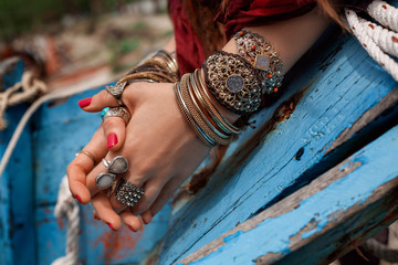 close up of gypsy style woman hands with jewelry