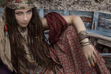 happy gypsy style young woman in boat