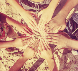 Multicultural childrens hands in a circle. Instagram effect