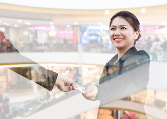 Businesspeople exchanging credit card with department store